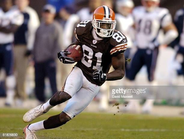 Antonio Bryant of the Cleveland Browns gains a first down during the third quarter against the New England Patriots at Cleveland Browns Stadium on...