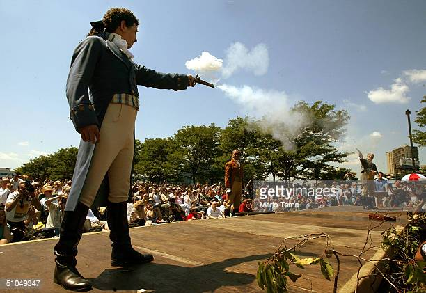Antonio Burr a descendant of Aaron Burr's cousin fires with Douglas Hamilton a fiithgreatgrandson of Alexander Hamilton during a reenactment marking...