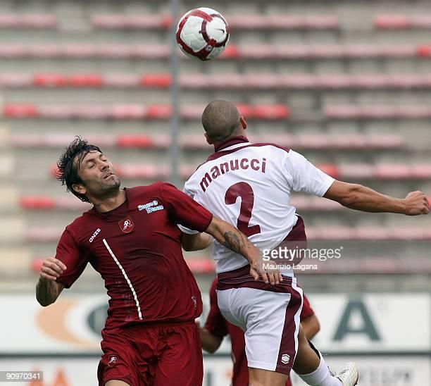 Antonio Busce' of Reggina Calcio is challenged by Andrea Menucci of AS Cittadella during the Serie B match between Reggina Calcio and Cittadella at...