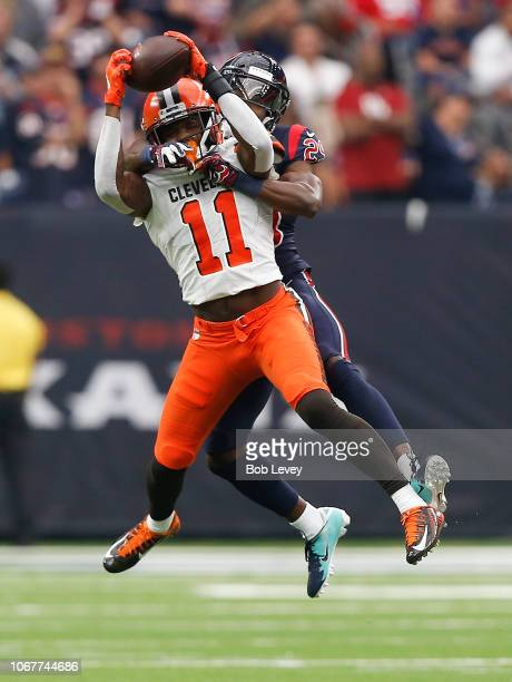 Antonio Callaway of the Cleveland Browns makes a catch in front of Andre Hal of the Houston Texans in the third quarter at NRG Stadium on December 2...