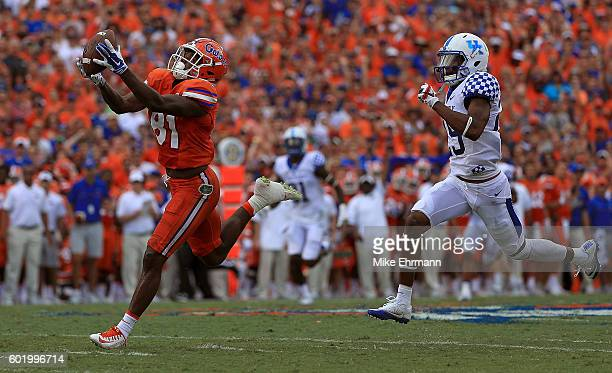 Antonio Callaway of the Florida Gators makes a catch for a touchdown during a game against the Kentucky Wildcats at Ben Hill Griffin Stadium on...