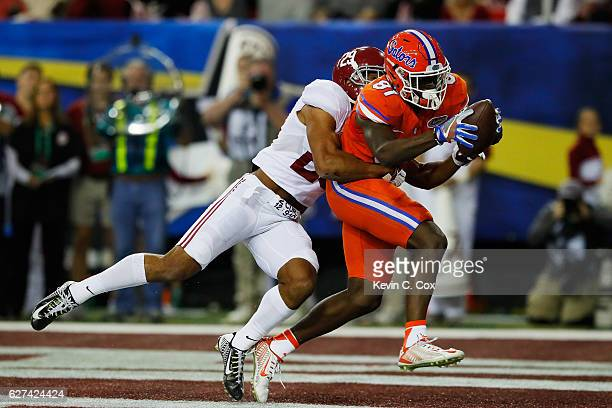 Antonio Callaway of the Florida Gators scores a first quarter touchdown as Minkah Fitzpatrick of the Alabama Crimson Tide defends during the SEC...