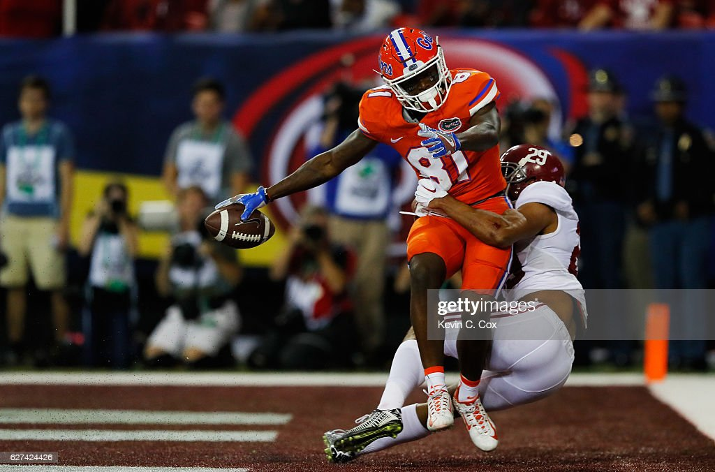 Antonio Callaway #81 of the Florida Gators scores a first quarter touchdown as Minkah Fitzpatrick #29 of the Alabama Crimson Tide defends during the SEC Championship game at the Georgia Dome on December 3, 2016 in Atlanta, Georgia.