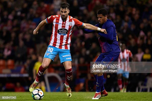 Antonio Campillo of CD Lugo is challenged by Marcus McGuane of FC Barcelona B during the La Liga 123 match between CD Lugo and FC Barcelona B at...