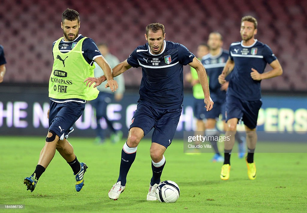 Antonio Candreva (L) and Giorgio Chiellini of Italy compete for the ball during a training session on October 14, 2013 in Naples, Italy.