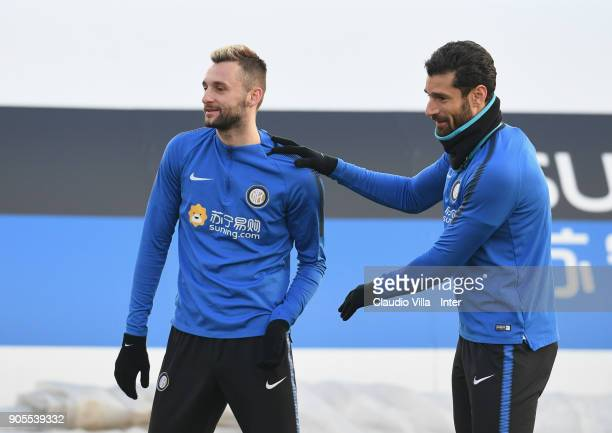 Antonio Candreva and Marcelo Brozovic of FC Internazionale chat during the FC Internazionale training session at Suning Training Center at Appiano...