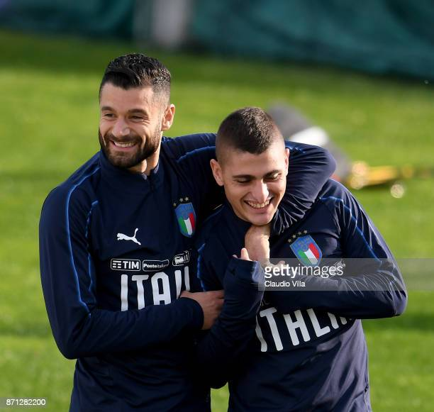 Antonio Candreva and Marco Verratti of Italy are joking during a training session at Italy club's training ground at Coverciano on November 7 2017 in...