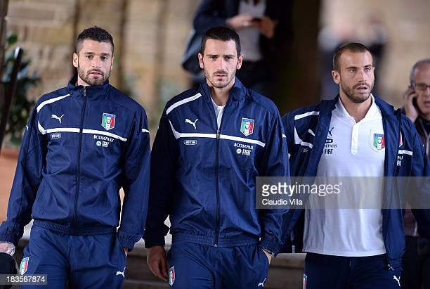 Antonio Candreva Leonardo Bonucci and Lorenzo De Silvestri of Italy attends a training session at Coverciano on October 7 2013 in Florence Italy