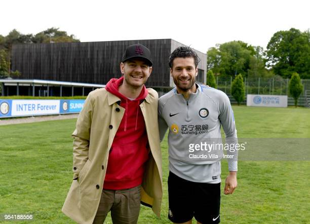Antonio Candreva of FC Internazionale and Alessandro Cattelan pose for a photo during the FC Internazionale training session at the club's training...