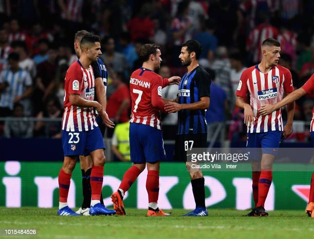 Antonio Candreva of FC Internazionale and Antoine Griezmann of Atletico Madrid chat at the end of the International Champions Cup 2018 match between...
