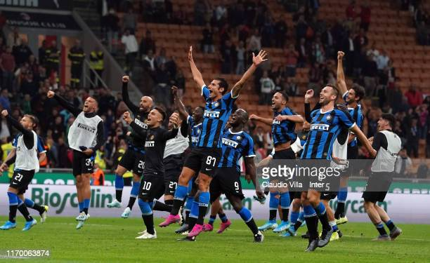 Antonio Candreva of FC Internazionale and teammates celebrate the victory at the end of the Serie A match between AC Milan and FC Internazionale at...