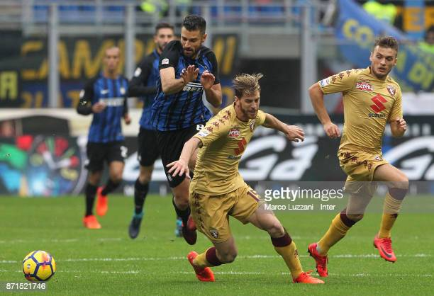 Antonio Candreva of FC Internazionale clashes with Cristian Ansaldi of Torino FC during the Serie A match between FC Internazionale and Torino FC at...