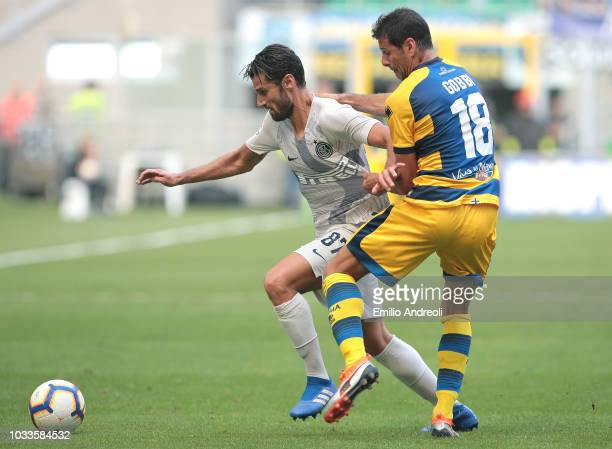Antonio Candreva of FC Internazionale competes for the ball with Massimo Gobbi of Parma Calcio during the serie A match between FC Internazionale and...