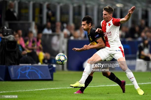 Antonio Candreva of FC Internazionale competes for the ball with Lukas Masopust of SK Slavia Praha during the UEFA Champions League football match...