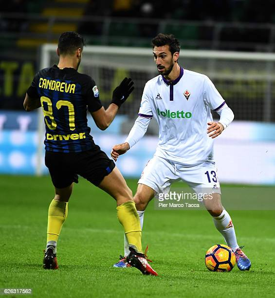 Antonio Candreva of FC Internazionale competes for the ball with Davide Astori of ACF Fiorentina during the Serie A match between FC Internazionale...