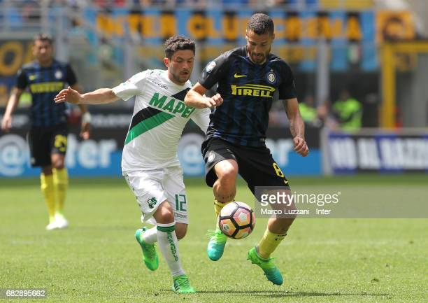 Antonio Candreva of FC Internazionale competes for the ball with Stefano Sensi of US Sassuolo during the Serie A match between FC Internazionale and...