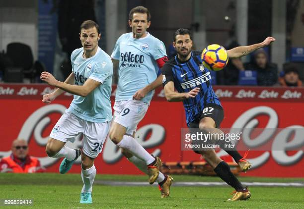Antonio Candreva of FC Internazionale competes for the ball with Stefan Radu of SS Lazio during the serie A match between FC Internazionale and SS...