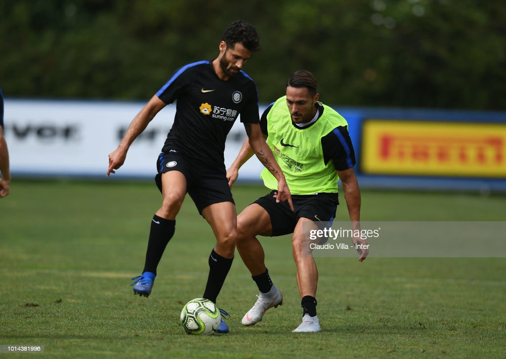 Antonio Candreva of FC Internazionale (L) in action during the FC Internazionale training session at the club's training ground Suning Training Center in memory of Angelo Moratti at Appiano Gentile on August 10, 2018 in Como, Italy.