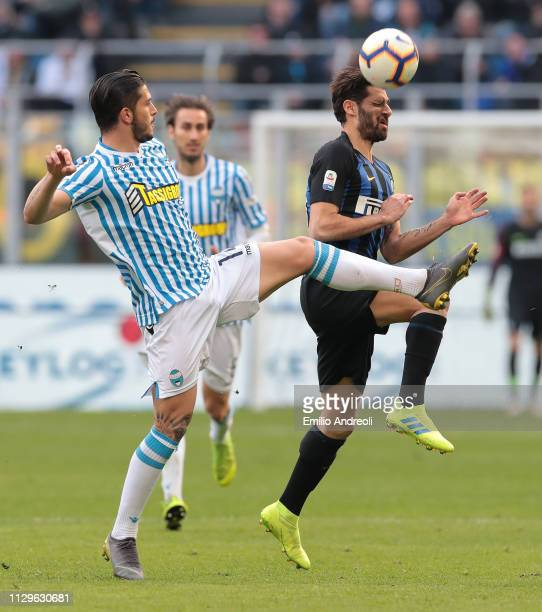 Antonio Candreva of FC Internazionale jumps for the ball against Kevin Bonifazi of Spal during the Serie A match between FC Internazionale and SPAL...