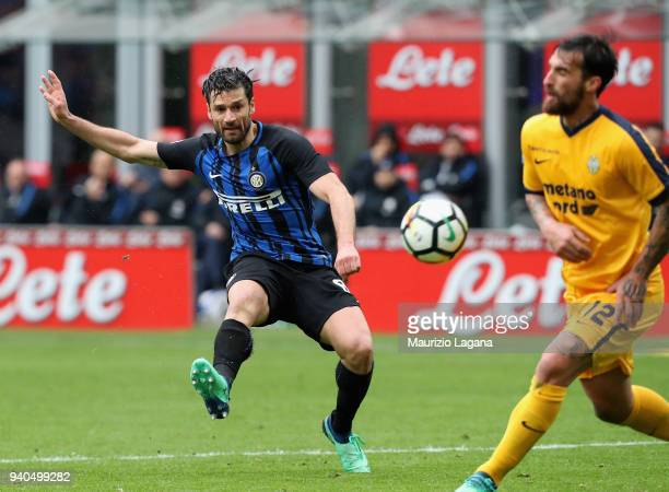 Antonio Candreva of Inter competes for the ball with Antonio Caracciolo during the serie A match between FC Internazionale and Hellas Verona FC at...