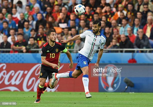 Antonio Candreva of Italy and Eden Hazard of Belgium compete for the ball during the UEFA EURO 2016 Group E match between Belgium and Italy at Stade...