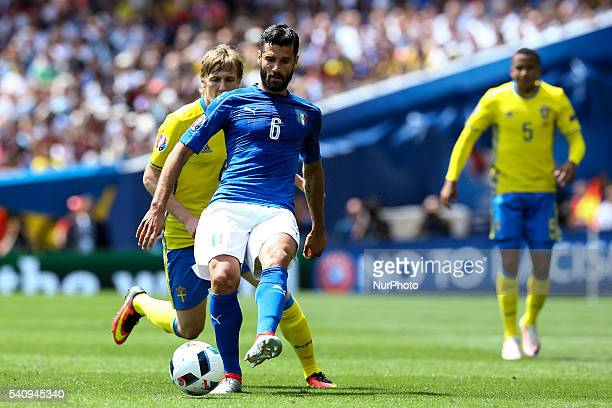 Antonio Candreva of Italy is challenged by Emil Forsberg of Sweeden during the UEFA EURO 2016 Group E match between Italy and Sweden at Stadium...