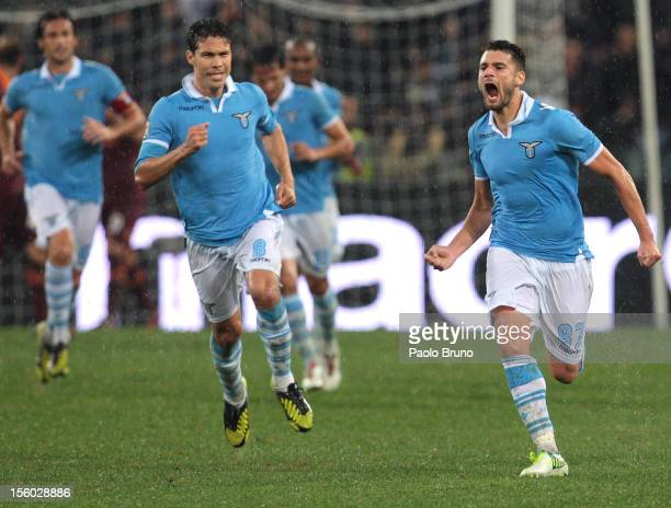 Antonio Candreva of SS Lazio celebrates with teammates after scoring their team's first goal during the Serie A match between SS Lazio and AS Roma at...