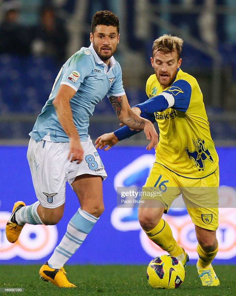 Antonio Candreva (L) of S.S. Lazio competes for the ball with Luca Rigoni of AC Chievo Verona during the Serie A match between S.S. Lazio and AC Chievo Verona at Stadio Olimpico on January 26, 2013 in Rome, Italy.