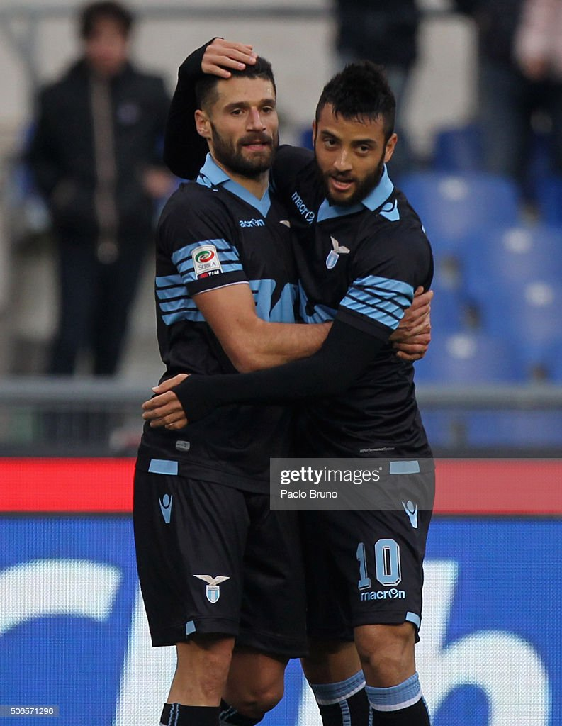 Antonio Candreva (L) with his teammate Felipe Anderson of SS Lazio celebrates after scoring the team's third goal during the Serie A match between SS Lazio and AC Chievo Verona at Stadio Olimpico on January 24, 2016 in Rome, Italy.