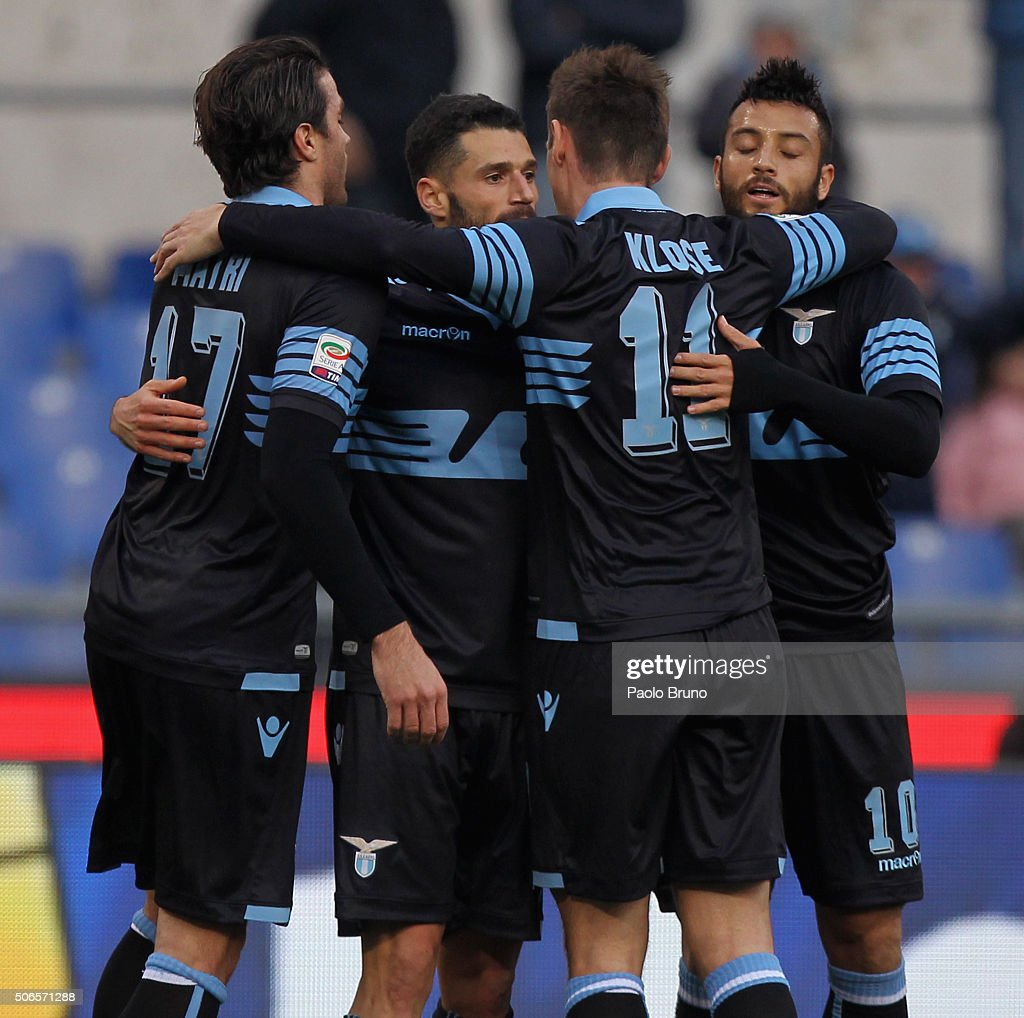 Antonio Candreva (C) with his teammates of SS Lazio celebrates after scoring the team's third goal during the Serie A match between SS Lazio and AC Chievo Verona at Stadio Olimpico on January 24, 2016 in Rome, Italy.