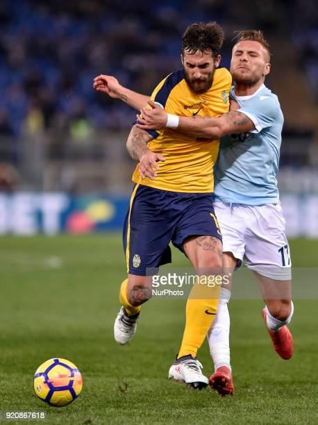 Antonio Caracciolo of Hellas Verona challenges Ciro Immobile of Lazio during the Serie A match between Lazio and Hellas Verona at Olympic Stadium...