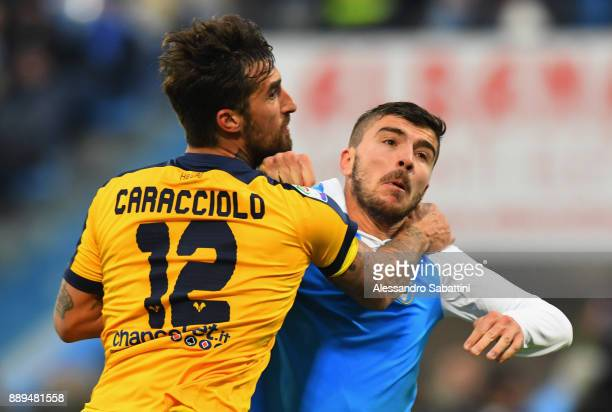 Antonio Caracciolo of Hellas Verona competes for the ball whit Alberto Paloschi of Spal during the Serie A match between Spal and Hellas Verona FC at...