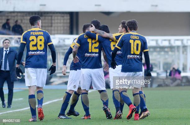 Antonio Caracciolo of Hellas Verona is mobbed by team mates after scoring his opening goal during the Serie A match between Hellas Verona FC and AC...