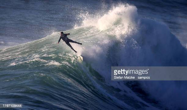 Antonio Cardoso of Portugal with a wipeout on December 28, 2019 in Nazare, Portugal.