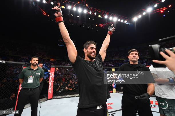 Antonio Carlos Junior of Brazil celebrates after defeating Jack Marshman of South Wales by submission in their middleweight bout during the UFC Fight...