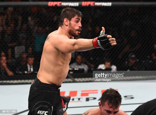 Antonio Carlos Junior of Brazil celebrates after submitting Jack Marshman of South Wales in their middleweight bout during the UFC Fight Night event...