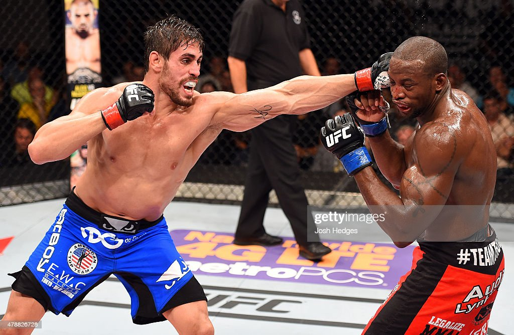 Antonio Carlos Junior of Brazil punches Eddie Gordon in their middleweight during the UFC Fight Night event at the Hard Rock Live on June 27, 2015 in Hollywood, Florida.