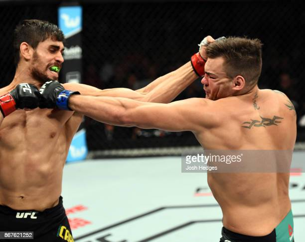 Antonio Carlos Junior of Brazil punches Jack Marshman of South Wales in their middleweight bout during the UFC Fight Night event inside the...