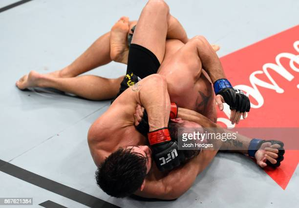 Antonio Carlos Junior of Brazil submits Jack Marshman of South Wales in their middleweight bout during the UFC Fight Night event inside the...