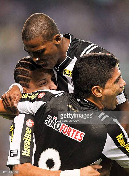 Antonio Carlos, Maicosuel and Renato of Botafogo celebrate a scored goal againist America MG during a match as part of Serie A 2011 at Engenhao...