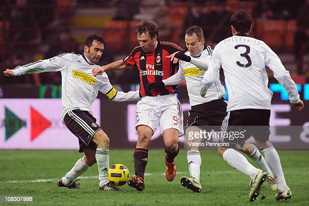 Antonio Cassano of AC Milan is challenged by Giuseppe Colucci and Steve Von Bergen of AC Cesena during the Serie A match between AC Milan and AC...