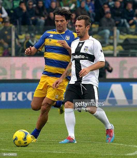 Antonio Cassano of Crociati Parma competes with Fernando Couto of Gialloblu Parma during the match between Gialloblu Parma and Crociati Parma for the...