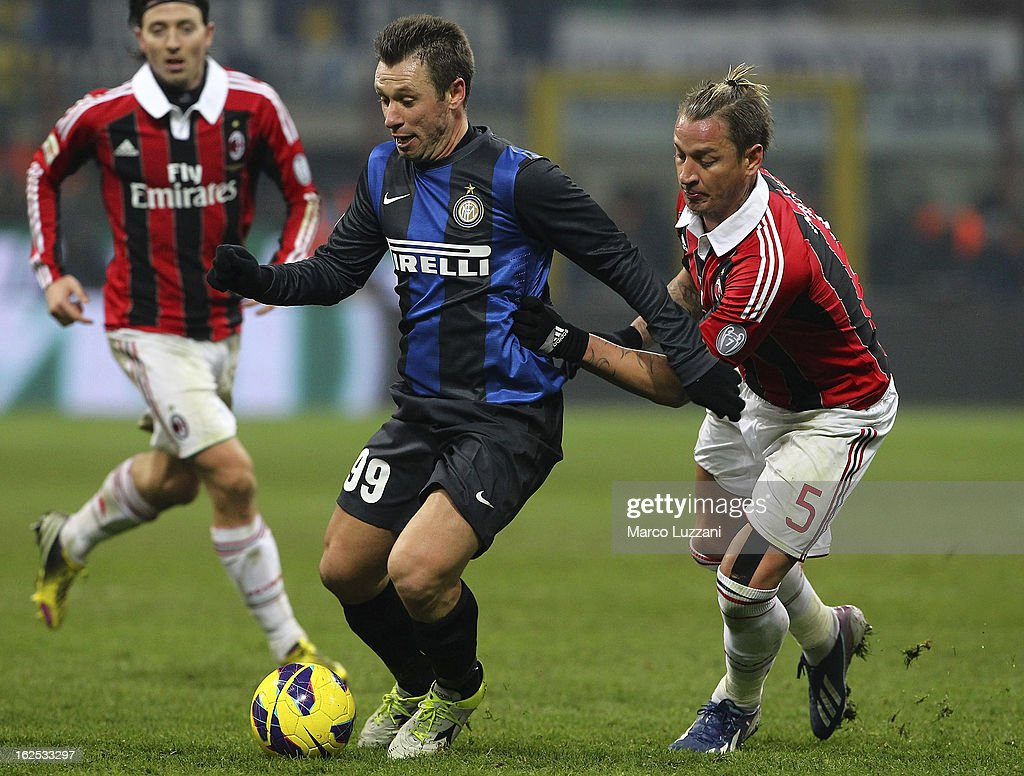 Antonio Cassano of FC Internazionale Milano competes for the ball with Philippe Mexes of AC Milan during the Serie A match FC Internazionale Milano and AC Milan at San Siro Stadium on February 24, 2013 in Milan, Italy.