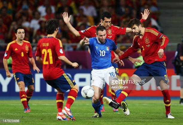 Antonio Cassano of Italy battles for the ball with Sergio Busquets David Silva and Gerard Pique of Spain during the UEFA EURO 2012 final match...