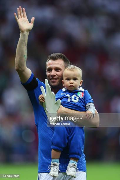 Antonio Cassano of Italy waves to the fans as he holds his son Christopher Cassano during the UEFA EURO 2012 semi final match between Germany and...