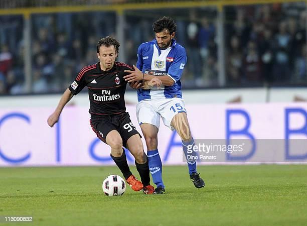Antonio Cassano of Milan competes with Marco Zambelli of Brescia during the Serie A match Brescia Calcio and AC Milan at Mario Rigamonti Stadium on...