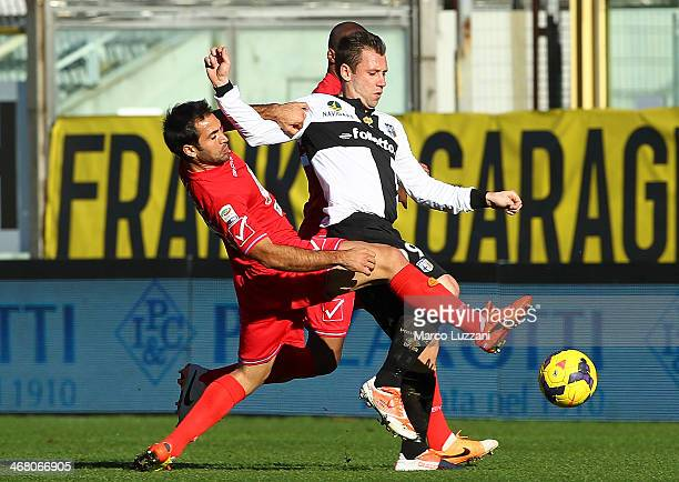 Antonio Cassano of Parma FC competes for the ball with Fabian Andres Rinaudo of Calcio Catania during the Serie A match between Parma FC and Calcio...