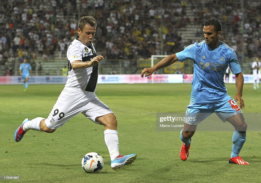 Antonio Cassano of Parma FC competes for the ball with Jeremy Morel of Olympique de Marseille during the pre-season friendly match between Parma FC and Olympique de Marseille at Stadio Ennio Tardini on July 31, 2013 in Parma, Italy.