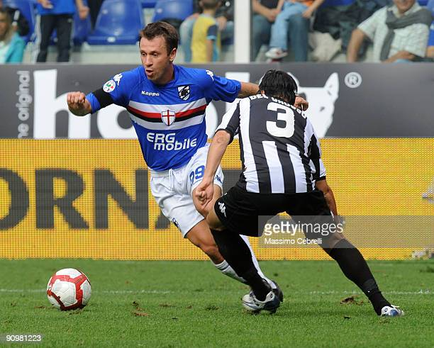 Antonio Cassano of UC Sampdoria and Criistiano del Grosso of AC Siena challenge for the ball during the Serie A match between UC Sampdoria and AC...