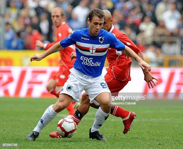Antonio Cassano of UC Sampdoria battles for the ball against Sergio Bernardo Almiron of AS Bari during the Serie A match between UC Sampdoria and AS...